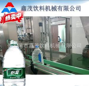 小瓶装饮用水灌装辅助设备